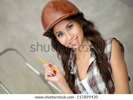 Painting worker looking at brushes before work