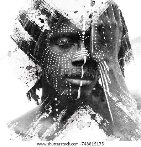 Paintography. African man with traditional style face paint dissolving behind smoky and ink texture