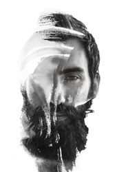 Paintography. The glance of a cool yet serious young guy fades behind brush strokes of ink