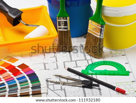 Paints, brushes and accessories for repair to architectural drawing.This composition recommend using advertising tools and materials for the repair of articles in magazines and on the Internet.