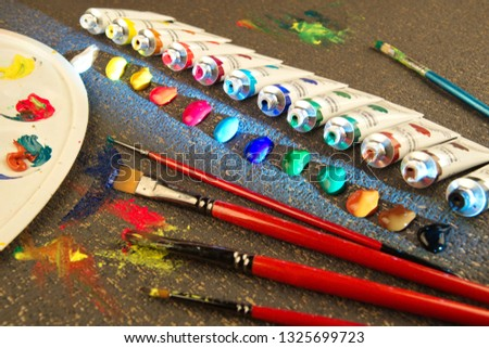 Paints brushes,palette, watercolors,acrylic and pastels.Drawing tutorial.Painting accessories.Art education.Creative art contcept.