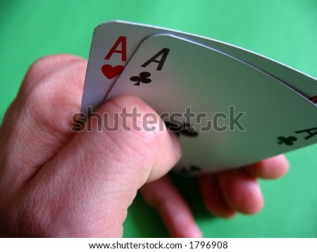 pair aces (heart and club) on green background...