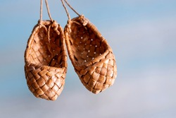 Pair bast shoes on a blue background.