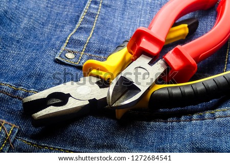 pair cutting pliers hand tools electrician building closeup red yellow handle