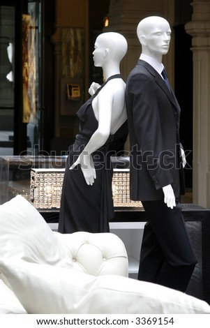Pair dummies in a show-window of shop of fashionable clothes - stock photo