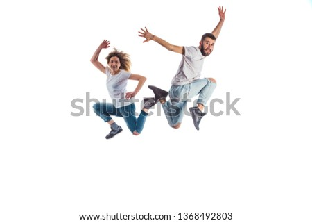 Pair of aerobic dancers are jumping isolated  on white background