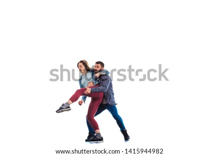 Pair of aerobic dancers are practicing on white background