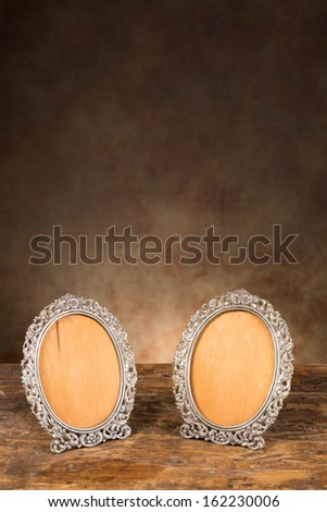 Pair of antique photo frames without portraits in them