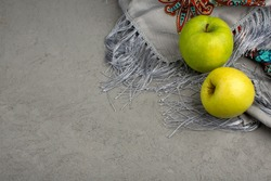 pair of apples green sweet mellow on a silky tissue and grey floor