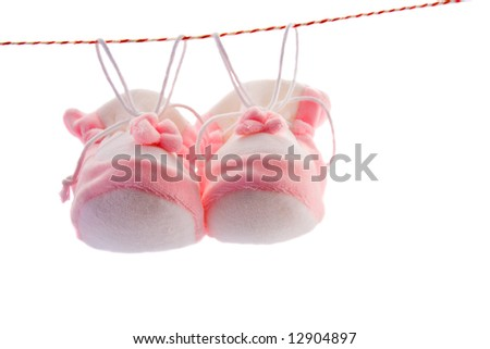 Pair of baby's slippers hanging on a rope. Including copy space.