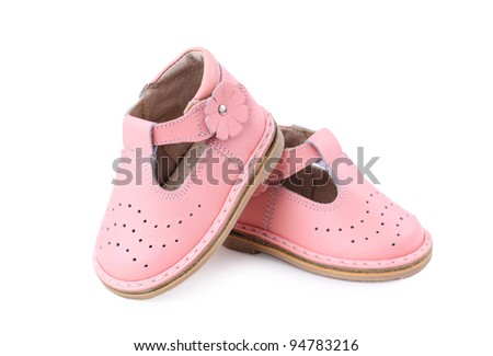 pair of baby shoes over a white background