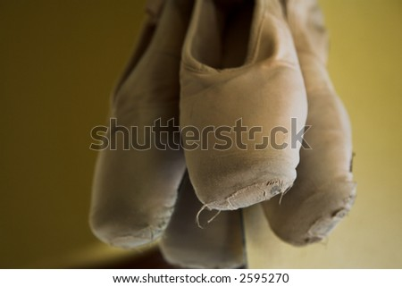 Pair of Ballet shoes hanging on the wall against a mirror – Shallow Depth of Field