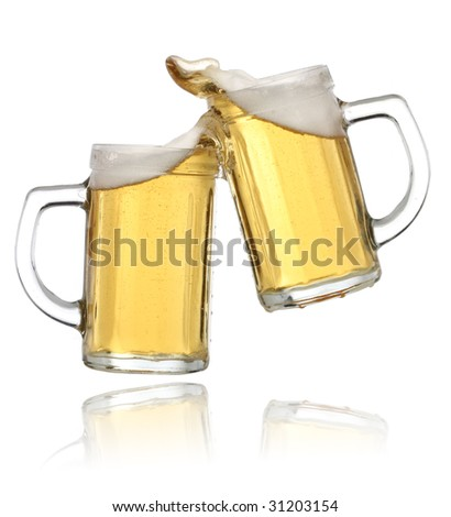 Pair of beer glasses making a toast. Beer splash