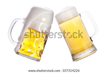 Pair of beer glasses making a toast isolated on a white background