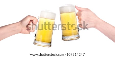 Pair of beer glasses with hand making a toast isolated on a white background