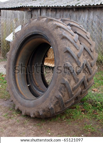 Pair of big used dirty tractor tyres