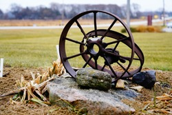 Pair of bigger Vintage old fashion rusted metal iron wagon wheel hub found outside of Campbellsport, Wisconsin