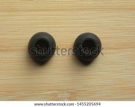 Pair of black color earphone pads of in-ear earphones