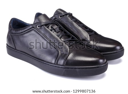 Pair of black colour sneakers style men shoe isolated on white background #1299807136