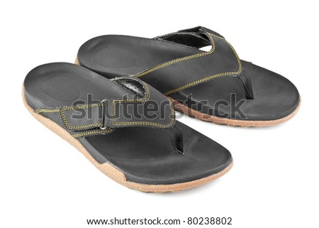 pair of black flip flops isolated on white background