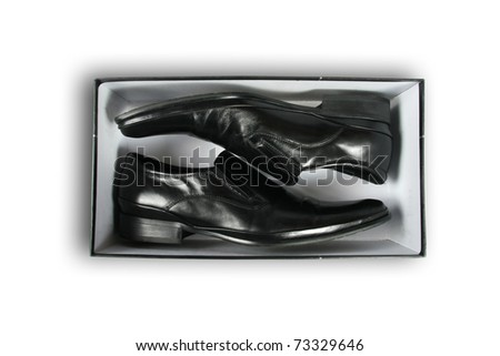 pair of black leather shoes inside a box