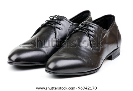 Pair of black male classic shoes on white background