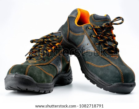 Pair of black safety leather shoes isolated on white background with copy space. Work shoes for men in factory or industry to protect foot from accident. Safety footwear. Oil and acid resistant shoes - Shutterstock ID 1082718791