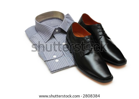 Pair of black shoes and new shirt isolated on white