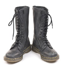Pair of black worn old combat boots. Isolated on white background.
