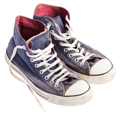 pair of blue sneakers on a white background