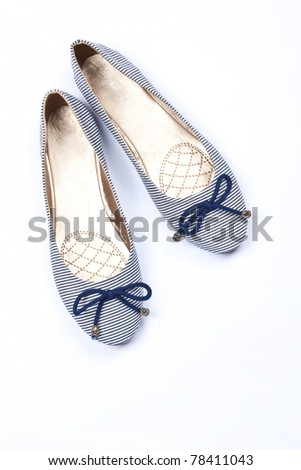 Pair of blue woman shoes isolated on white background