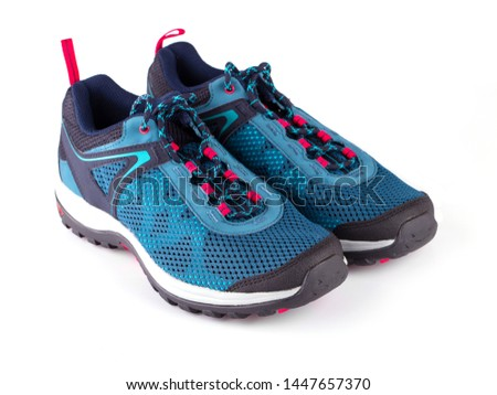 Pair of blue women's sneakers isolated on white bacxkground