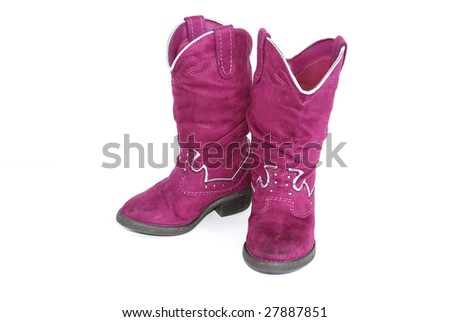 Pair of bright pink cowgirl boots on white background.