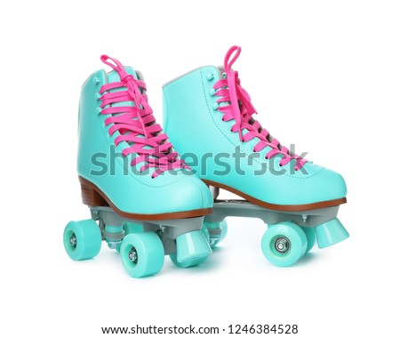 Pair of bright stylish roller skates on white background #1246384528