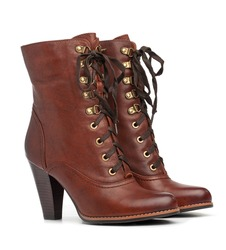 Pair of brown female boots over white background