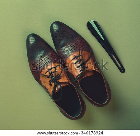 pair of brown leather shoes  #346178924