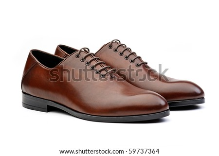Pair of brown male classic shoes isolated on white background