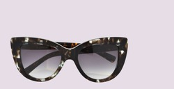 Pair of cateye sunglasses in pinkish background