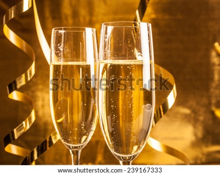 Pair of champagne flutes against a dark background