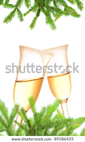 Pair of champagne flutes and Christmas decoration on white background