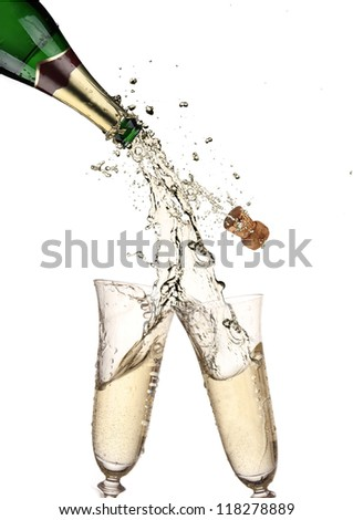 Pair of champagne flutes making a Champagne splash
