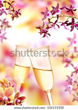 Pair of champagne flutes on orchid background
