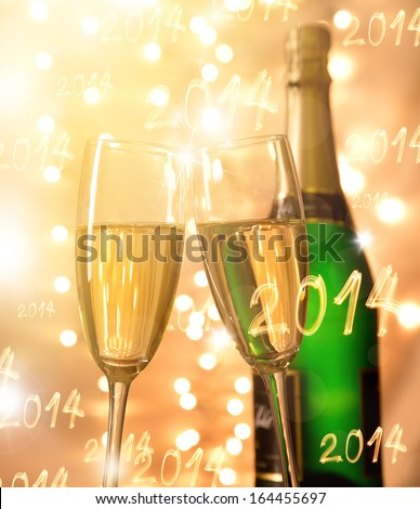 Pair of champagne flutes over gold background