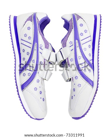 Pair of childrens shoes is isolated on a white background