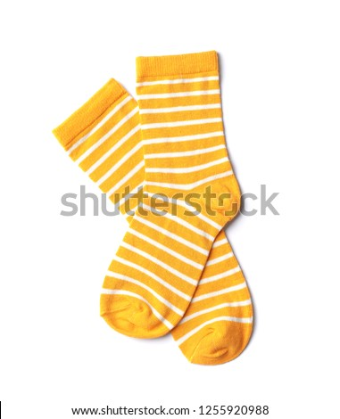 Pair of cute child socks on white background, top view