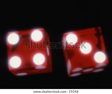 Pair of dice with the lucky number seven, isolated on black background.