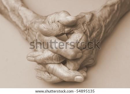 pair of elderly wrinkled hands in prayer