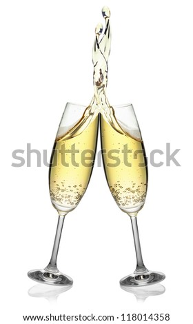Pair of flutes making an elegant splash of champagne, isolated on the white background, clipping path included.