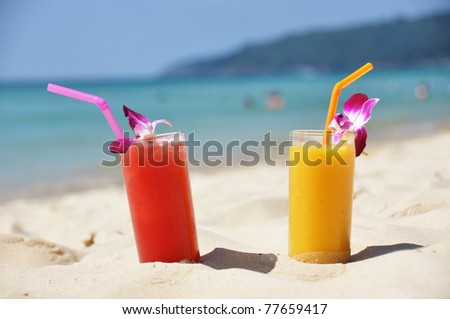 Pair of fruit shakes on the tropical beach