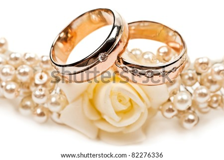 Pair of golden wedding rings. Isolated on white background